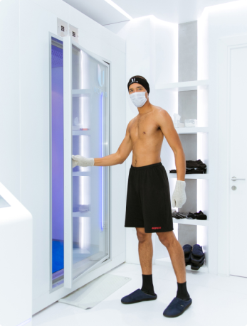 man entering cryotherapy chamber ucryo